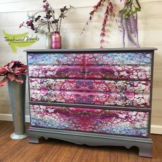 Dirty pour decoupage dresser Are you looking for the ultimate statement piece? This one of a kind dresser is decoupaged with fabric that was created from a paint pour technique. How cool is that?! The piece itself is painted in slate grey with just a few hot pink highlights and in order to let the fabric be the showcase we installed glass knobs so as not to interrupt the cool pattern. The drawers are dovetailed and the piece is solid wood. Perfect as a dresser , sideboard, changing table, or…