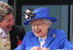 A picture of happiness: The Queen wearing her grandmother Queen Mary's Russian diamond and sapphire brooch, shares and amusing moment with her racing manager John Warren at the Epsom Derby on 2nd June 2012