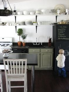 Is it dumb to have a chalk board fridge if you don't have any kids?? Ha.  I want one.
