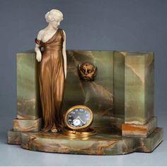 """PREISS, Ferdinand The Spring. Escultura de bronze e marfim, base de ônix, apresenta relógio acoplado em sua base. 31,5 x 19,5 x 28 cm de altura. França, c. 1930.  Esta é a própria peça que encontra-se reproduzida no livro """"Art Deco   Villa Antica  05 e 06 de julho às 20:30 hs  www.iarremate.com.br  iArremate, aqui nós gostamos de arte .    #villaantica #preiss #artdeco #leilao #antiques #remates #bid #iarremate #luxury #leilaoonline #leilaodearte #arteonline #antiques #sculpture"""