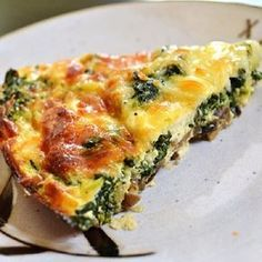 Oven baked spinach and mushroom tart.Cheesy tart with spinach and mushroom cooked in oven.