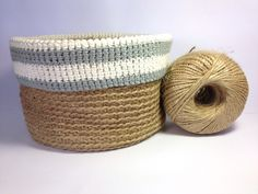 A basket crocheted with garden twine and finished with a contrasting grey and cream cotton trim.   Perfect for storing your odds and ends.   Dimensions 21cm dia, 15cm high