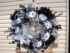 This wreath is made using deco mesh in a black and white stripe color. I have a beautiful white and black 2.5 ribbon and also a black net 2.5