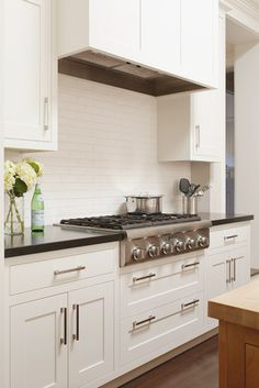 classic kitchen with white cabinets + subway tile