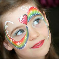 Rainbow face painting idea by Pixie Face Painting and Portraits