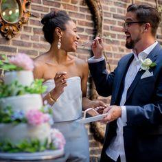 Gorgeous interracial couple tasting their wedding cake at their wedding celebration #love #wmbw #bwwm #swirl #wedding #lovingday #relationshipgoals