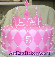 Pink fondant diamonds and white pearls princess girl's 5th birthday cake with edible crown topper