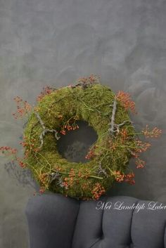 Krans. ~ Moss wreath , with what appears to be bittersweet berries.