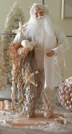 Coastal Christmas ...love this!  I could use my shells to enhance my white Santa...                                                                                                                                                     More