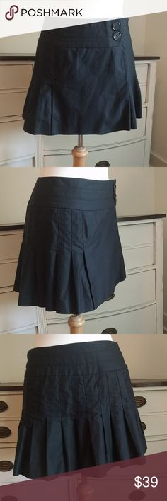 Adorable bebe mini skirt Pleated and buttons on side, fully pleated in back. Excellent condition. Worn once. bebe Skirts Mini