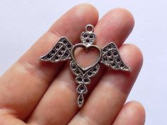 Angel Wing Heart Charm by StashofCharms on Etsy
