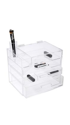 Clear acrylic composes this GLAMboxes jewelry organizer. The top tier has a lidded section, an open compartment, and an optional brush container. 3 drawers. Optional dividers.
