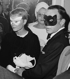Reporters swarm Frank Sinatra and his wife, actress Mia Farrow, as they arrive at Truman Capote's Black and White Ball.   – Image by © Bettmann/CORBIS