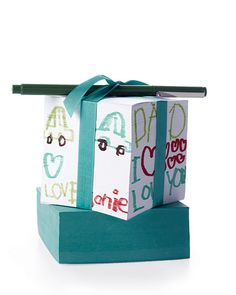 Blank paper block...kids draw on sides...attach pen...Voila...cute Father's Day gift!