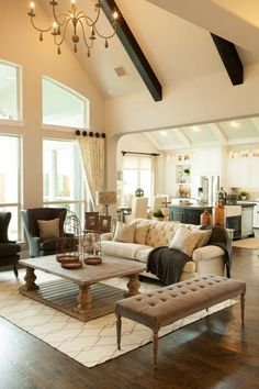 Beautiful living room design by Shaddock Homes (http://www.shaddockhomes.com/) on houzz.com || modern rustic traditional fixer upper style, tufted sofa, beams, hardwood floors, living room layout ideas and inspiration