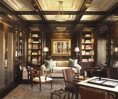 There's no denying that a dark, paneled den is one of our all-time favorite rooms. When it's as exquisitely designed as this one it's all the better.
