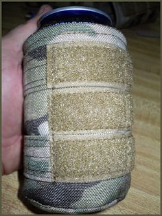 Original SOE -- Tactical Beer Coozie -- Padded insulation. Pals on the outside to attach to gear and just look badass covering your beer or soda can. Velcro to attach you favorite SOE patch.