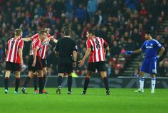 Sunderland players appeal to referee Kevin Friend after Diego Costa of Chelsea (R) clashes with Wes Brown of Sunderland (not pictured) during the Barclays Premier League match between Sunderland and Chelsea at Stadium of Light on November 29, 2014 in Sunderland, England.