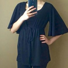 Black layering top Layering top with tie front. Slouchy fit - can fit Medium or maybe Large. American Rag Tops Tunics