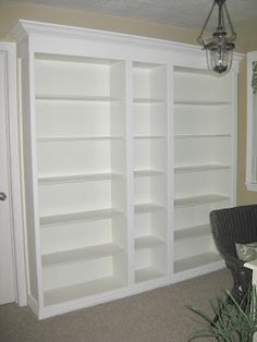 DIY built-in. Total project $250. Ikea BILLY bookcases and add some molding. You can paint the backs in any fun color.