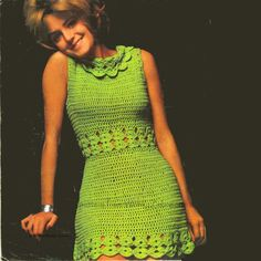A crochet dress in classic sixties style with a neat little shape and lovely roll neck collar on the neckline.   Unusual in design as the main part is
