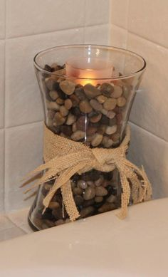 Add pebbles, seashells, buttons, coffee beans, dried beans, or whatever you like to complete the look.  Add decorate ribbons for a finishing touch.