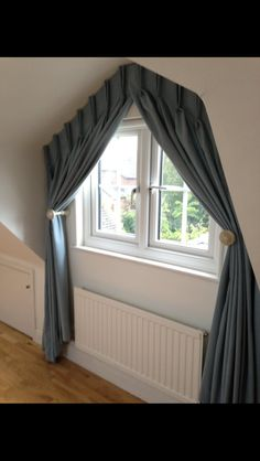 Fixed heading curtains at an apex window