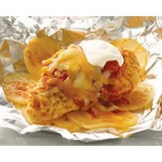 Foil-Pack Taco Chicken and Potatoes - Seasoned chicken, potatoes and cheese cooked in individual foil packs.