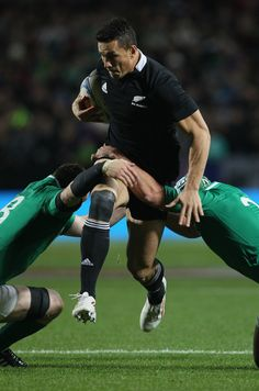 Sonny Bill Williams of the All Blacks leaps through a tackle during the International Test Match between New Zealand and Ireland at Waikato Stadium on June 23, 2012 in Hamilton, New Zealand.       (Photo by Sandra Mu)