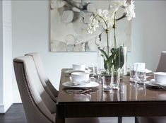 Modern Home with Elegant Interiors century dining table, linen covered chairs