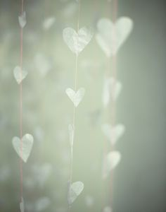 looks like tissue paper hearts on light pink string. so delicate