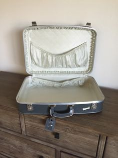 A personal favorite from my Etsy shop https://www.etsy.com/listing/491037686/vintage-luggage-carousel-suitcase