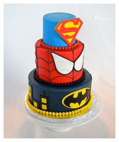 Superheroes Cake make me think of me, my hubby, and my sister-in-law!