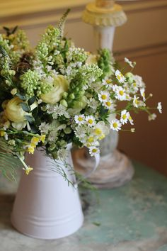 Relaxed rustic Spring jug of flowers | White and buttermilk yellow Spring style wedding flowers at Millbridge Court located in Frensham, Surrey. Created by Hannah Berry Flowers hannahberryflowers.co.uk