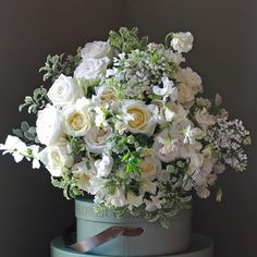 A wonderfully scented luxury bouquet filled with ivory & cream roses, hand tied with English Sweet Peas, white Astrantia, scented English narcissi. http://www.realflowers.co.uk/mothers-day-collection/luxury-massed-english-sweet-pea-bouquet.html