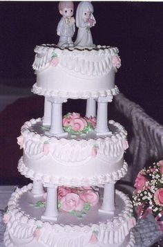 traditional wedding cake with pink flowers