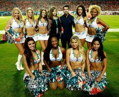 MIAMI GARDENS, FL - OCTOBER Joe Jonas of the Jonas Brothers poses for a photograph with the Miami Dolphins cheerleaders during a game against the Cincinnati Bengals at Sun Life Stadium on October 2013 in Miami Gardens, Florida. Miami Cheerleaders, Dolphins Cheerleaders, Sun Life Stadium, Miami Gardens, October 31, Joe Jonas, Jonas Brothers, Cincinnati Bengals, Miami Dolphins