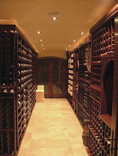 A wine room with our custom mahogany wine racks. Shop for racks like them at WineRacks.com