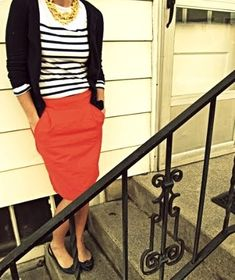 striped shirt worn with red skirt and cardi