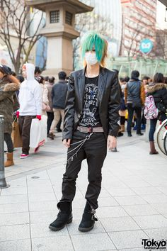 Keisuke is wearing a jacket from Magic with a Ghost of Harlem t-shirt and a pair of jeans. He accessorized with a cross and skull necklace, jeweled belt, and chains, which are also from Ghost of Harlem. His studded boots are by the Japanese brand Buffalo Bobs.