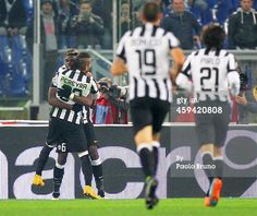 Paul Pogba with his teammate Roberto Pereyra of...