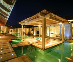 Outdoor living room in the middle of a pool.