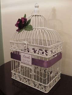 Like the idea of having a bird cage for cards. On eBay for 19.99 and could wrap small wire pink flowers around