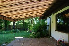 The fixed/stationary residential awning is a fixed frame awning for use over patios and decks. It provides 3 season comfort and protection from the sun and rain. http://www.breslow.com/