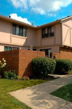 Carnaby Village Townhomes are beautiful Columbus apartments, located on McNaughten Road, just east of Basement For Rent, Townhouse, Apartments, Ohio, Garage Doors, The Unit, Mansions, House Styles, Outdoor Decor