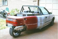 My reverse trike I built I call it a TRYOTA Its made from a 1990 toyota corolla FWD 5spd.handles great and is a real head turner