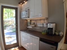 Coordinating Style without replicating it.  A second sink & beverage refrigerator are great additions as well as Microwave and coffee out of the open plan kitchen.