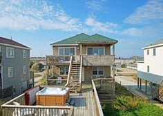 Summer Wind is a 4 bed 3 bath oceanfront Outer Banks rental that sleeps 10.  Located in Kill Devil Hills.