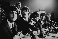 The Beatles ( Paul McCartney,Ringo Starr, George Harrison, John Lennon) at a press conference. c. 1964