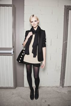 love that she kept her shorts with tights look simple: a camel sweater, black boyfriend blazer and sleek booties are all she needs to keep it so chic